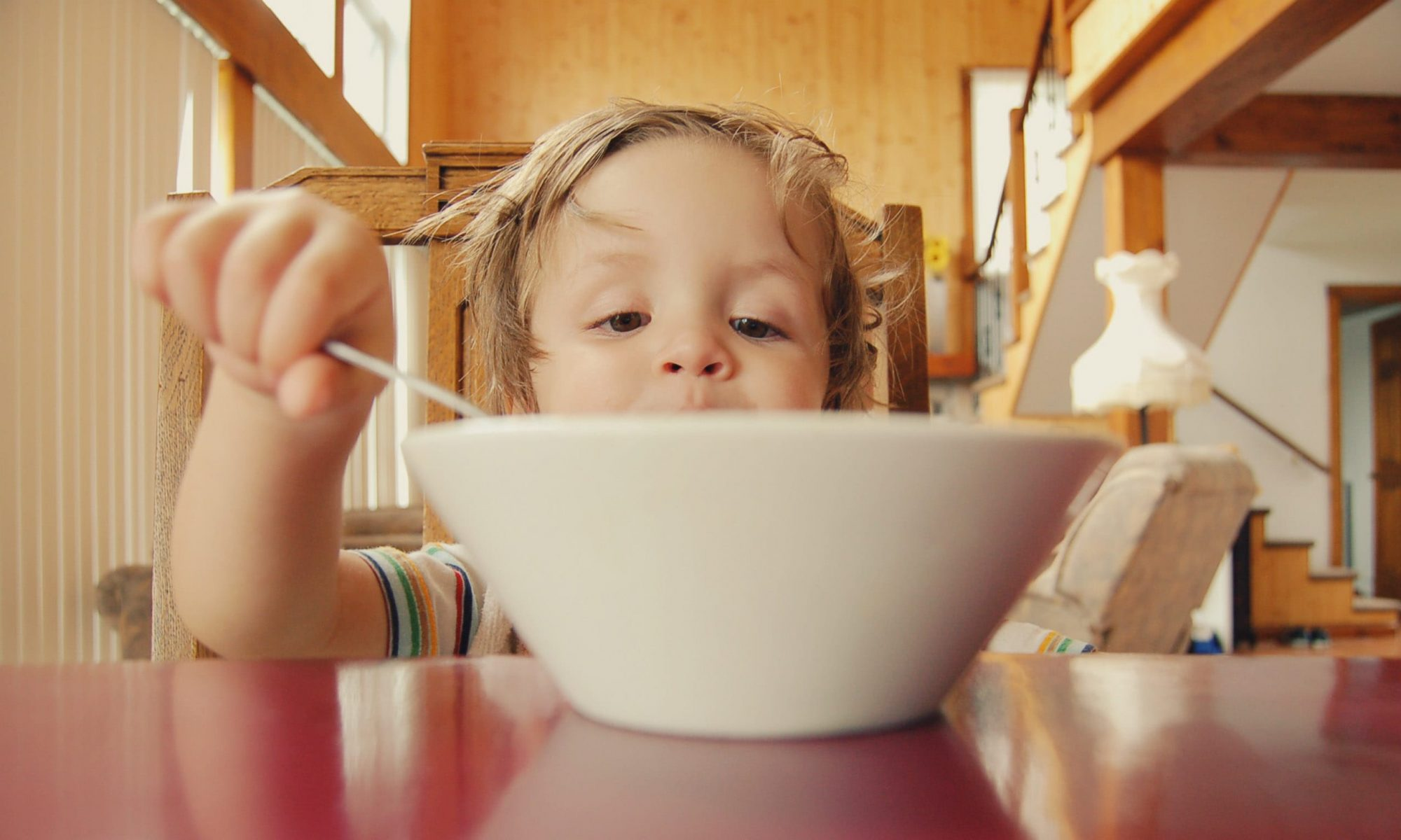 Boy eating cereal at home