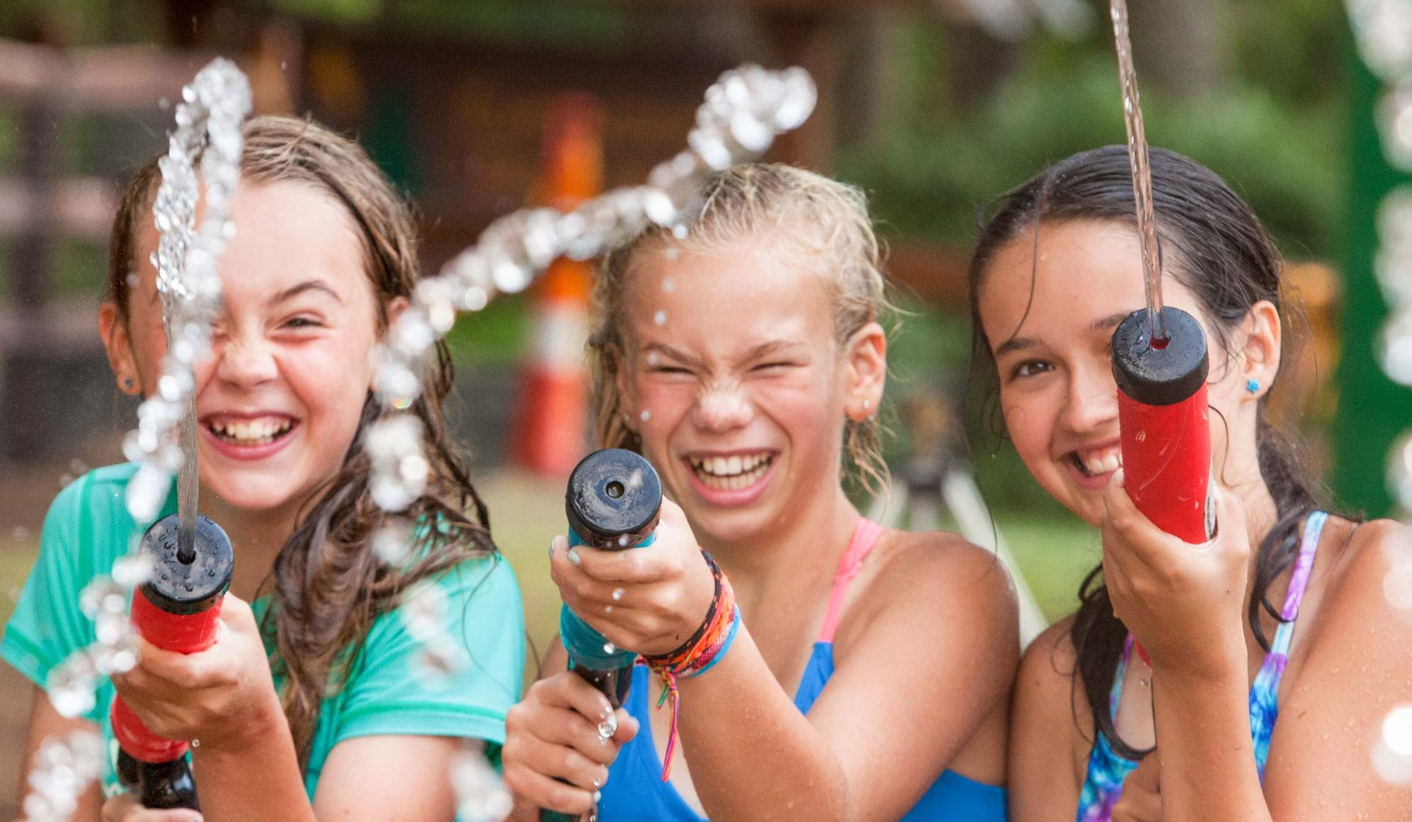Girls squirting water guns